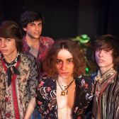 The mothers of the musicians in the Greta Van Fleet band – from left, Karen  Kiszka and Lori Wagner – show off some of the swag available for ...
